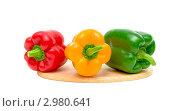 Купить «Три разноцветных сладких перца на белом фоне», фото № 2980641, снято 26 ноября 2011 г. (c) Ласточкин Евгений / Фотобанк Лори