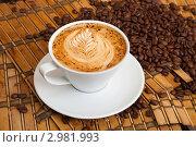 Купить «Чашка эспрессо с рисунком на пенке», фото № 2981993, снято 22 ноября 2011 г. (c) Владимир Мельников / Фотобанк Лори
