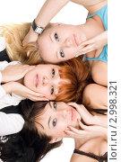 Купить «Три привлекательные женщины лежат на белом фоне», фото № 2998321, снято 7 января 2010 г. (c) Сергей Сухоруков / Фотобанк Лори
