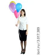 Купить «Девушка в белой блузке и черной юбке протягивает  воздушные шарики», фото № 3017389, снято 10 марта 2011 г. (c) Величко Микола / Фотобанк Лори
