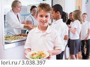 Купить «Школьник с тарелкой обеда в столовой», фото № 3038397, снято 30 марта 2000 г. (c) Monkey Business Images / Фотобанк Лори