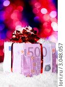 Купить «Подарочная коробка из евро на цветном фоне», фото № 3048057, снято 23 сентября 2018 г. (c) Сергей Петерман / Фотобанк Лори