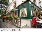 Купить «Красиво оформленное уличное кафе в районе Монмартра. Франция. Париж», фото № 3048185, снято 8 октября 2011 г. (c) Яна Королёва / Фотобанк Лори