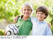 Купить «Портрет двух мальчиков с футбольным мячом в руках», фото № 3059977, снято 18 января 2007 г. (c) Monkey Business Images / Фотобанк Лори