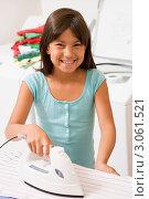 Купить «Девочка гладит белье в прачечной», фото № 3061521, снято 4 октября 2007 г. (c) Monkey Business Images / Фотобанк Лори