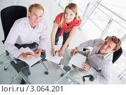 Купить «Три бизнесмена в переговорной радостно работают с документами», фото № 3064201, снято 29 октября 2006 г. (c) Monkey Business Images / Фотобанк Лори