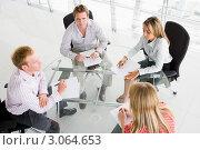 Купить «Четыре бизнесмена работают с документами в переговорной комнате», фото № 3064653, снято 29 октября 2006 г. (c) Monkey Business Images / Фотобанк Лори