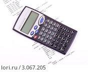Купить «Карманный калькулятор лежит на распечатке компьютерной программы», фото № 3067205, снято 7 декабря 2011 г. (c) a2bb5s / Фотобанк Лори