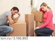 Купить «Усталая семейная пара в комнате с картонными коробками», фото № 3106893, снято 11 ноября 2010 г. (c) Monkey Business Images / Фотобанк Лори