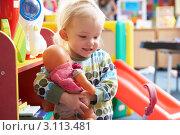 Купить «Маленькая девочка играет с куклой в детском саду», фото № 3113481, снято 16 октября 2010 г. (c) Monkey Business Images / Фотобанк Лори