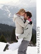 Купить «Мужчина держит на руках женщину, портрет на фоне гор», фото № 3115373, снято 18 января 2011 г. (c) Monkey Business Images / Фотобанк Лори