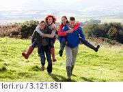 Купить «Мужчины катают своих женщин на спине в сельской местности», фото № 3121881, снято 4 октября 2010 г. (c) Monkey Business Images / Фотобанк Лори