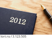 Купить «Крупно - датированный ежедневник на 2012 год и перьевая ручка», фото № 3123505, снято 11 августа 2011 г. (c) Monkey Business Images / Фотобанк Лори