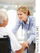 Купить «Женщина-врач помогает пожилому пациенту в инвалидном кресле», фото № 3124341, снято 28 февраля 2011 г. (c) Monkey Business Images / Фотобанк Лори