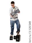 Купить «Молодой человек с четырьмя колонками», фото № 3129549, снято 5 февраля 2010 г. (c) Сергей Сухоруков / Фотобанк Лори
