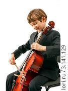 Купить «Мальчик исполняет музыку на виолончели», фото № 3141129, снято 11 мая 2009 г. (c) Владимир Мельников / Фотобанк Лори