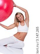 Купить «Портрет счастливой молодой женщины на полу с красным мячом для фитнеса», фото № 3147265, снято 3 апреля 2009 г. (c) CandyBox Images / Фотобанк Лори