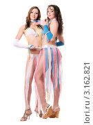 Купить «Две сексуальные девушки в костюмах из ленточек в полный рост на белом фоне», фото № 3162821, снято 13 февраля 2010 г. (c) Сергей Сухоруков / Фотобанк Лори