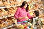 Счастливая молодая мама с сыном в супермаркете, фото № 3164153, снято 15 мая 2009 г. (c) CandyBox Images / Фотобанк Лори