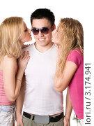 Радостный молодой мужчина и две целующие его девушки, фото № 3174941, снято 11 февраля 2010 г. (c) Сергей Сухоруков / Фотобанк Лори