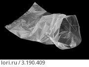 Купить «Полиэтиленовый мешок на черном фоне», фото № 3190409, снято 27 января 2012 г. (c) Андрей Пашков / Фотобанк Лори