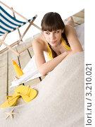Купить «Сексапильная девушка загорает на песке, рядом крем от солнца и жёлтые шлепанцы», фото № 3210021, снято 4 марта 2010 г. (c) CandyBox Images / Фотобанк Лори