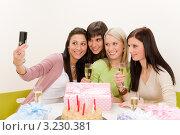 Купить «Четыре девушки на дне рождения фотографируются за столом с именинницей», фото № 3230381, снято 29 января 2011 г. (c) CandyBox Images / Фотобанк Лори