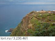Маяк на скалистом северном берегу острова Мадейра (Farol de Sao Jorge) (2011 год). Стоковое фото, фотограф Виктория Катьянова / Фотобанк Лори