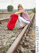 Купить «Женщина сидит на рельсах», фото № 3232917, снято 10 августа 2011 г. (c) Яков Филимонов / Фотобанк Лори