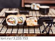 Японская кухня в ресторане. Стоковое фото, фотограф Наталия Китаева / Фотобанк Лори