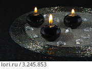 Купить «Натюрморт из горящих черных свечей на бисерной салфетке в интерьере», эксклюзивное фото № 3245853, снято 19 июня 2019 г. (c) Blekcat / Фотобанк Лори