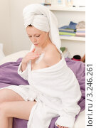 Купить «Девушка в халате и полотенце втирает крем в тело», фото № 3246261, снято 19 апреля 2011 г. (c) CandyBox Images / Фотобанк Лори