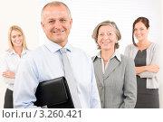 Купить «Улыбающийся мужчина средних лет с коллегами», фото № 3260421, снято 8 октября 2011 г. (c) CandyBox Images / Фотобанк Лори