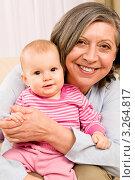 Купить «Портрет счастливой бабушки с маленькой внучкой на руках», фото № 3264817, снято 10 января 2012 г. (c) CandyBox Images / Фотобанк Лори