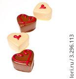 Купить «Шоколадные сердечки на белом фоне», фото № 3296113, снято 27 января 2012 г. (c) Аnna Ivanova / Фотобанк Лори