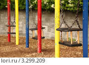 Купить «Качели на безлюдной детской площадке», фото № 3299209, снято 12 июня 2010 г. (c) Losevsky Pavel / Фотобанк Лори