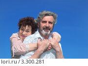 Купить «Женщина в возрасте обнимает мужа на свежем воздухе», фото № 3300281, снято 22 июня 2010 г. (c) Losevsky Pavel / Фотобанк Лори