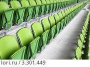 Купить «Зеленые сидения на пустой  трибуне стадиона», фото № 3301449, снято 10 июня 2010 г. (c) Losevsky Pavel / Фотобанк Лори