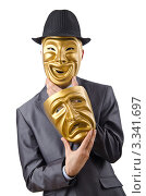 Купить «Бизнезмен в костюме, шляпе и золотой веселой маске держит в руке золотую грустную маску, белый фон», фото № 3341697, снято 17 декабря 2011 г. (c) Elnur / Фотобанк Лори