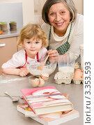 Купить «Портрет бабушки и внучки за приготовлением пирога», фото № 3353593, снято 28 января 2012 г. (c) CandyBox Images / Фотобанк Лори