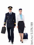 Купить «Пилот и стюардесса идут рядом на белом фоне», фото № 3376189, снято 22 сентября 2011 г. (c) Raev Denis / Фотобанк Лори