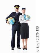 Купить «Мужчина в форме пилота и стюардесса держат в руках глобусы», фото № 3376193, снято 22 сентября 2011 г. (c) Raev Denis / Фотобанк Лори