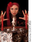 Купить «Гадалка за столом со свечами», фото № 3377853, снято 26 мая 2010 г. (c) Сергей Сухоруков / Фотобанк Лори