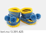 Вязанные пинетки для новорожденного ребенка. Стоковое фото, фотограф Светлана Кузнецова / Фотобанк Лори
