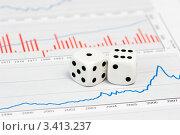 Купить «Две белые игральные кости лежат на финансовых диаграммах», фото № 3413237, снято 23 ноября 2008 г. (c) Дмитрий Наумов / Фотобанк Лори