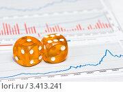 Купить «Два игральных кубика на графиках», фото № 3413241, снято 23 ноября 2008 г. (c) Дмитрий Наумов / Фотобанк Лори