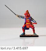Купить «Оловянная фигурка самурая телохранителя в бою», фото № 3415697, снято 30 марта 2012 г. (c) Олег Скударнов / Фотобанк Лори