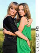 Купить «Две обнявшиеся симпатичные подруги», фото № 3421145, снято 10 июня 2010 г. (c) Сергей Сухоруков / Фотобанк Лори