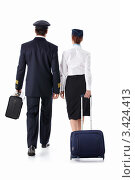 Купить «Пилот и стюардесса с чемоданами уходят», фото № 3424413, снято 22 сентября 2011 г. (c) Raev Denis / Фотобанк Лори