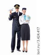Купить «Пилот с игрушечным самолетом в руке и стюардесса с глобусом», фото № 3424417, снято 18 октября 2018 г. (c) Raev Denis / Фотобанк Лори